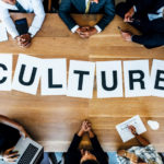 Business people discussing over work culture in meeting